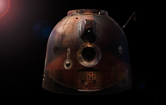 Image shows the Soyuz TMA-19M descent module on a black background