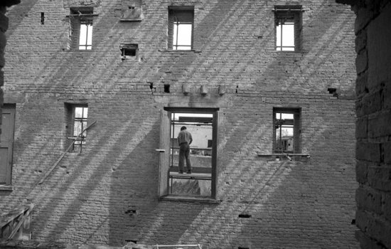 Black and white picture of man stood in a door way in the 1830 Warehouse at MSI