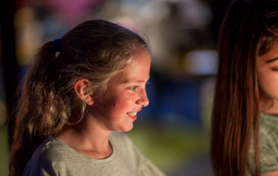 Girl with light shining on her face