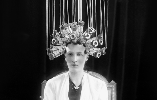 A black and whit picture of a model wearing electrical sensors on its head