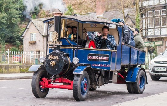 A Foden traction engine driving along a street