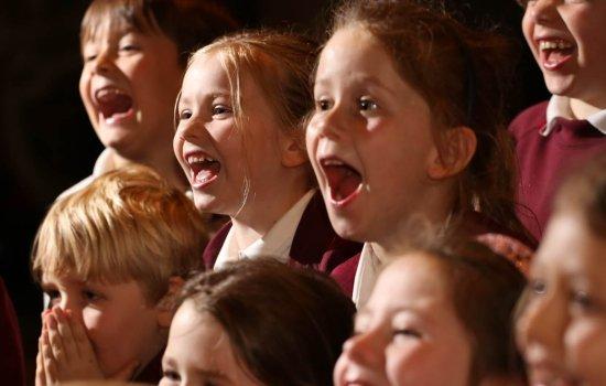 Schoolchildren in uniform with amazed looks on their faces