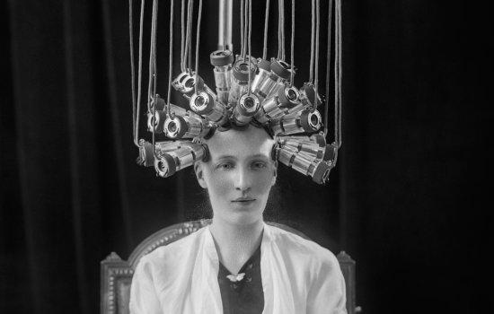 A black and white picture of a woman with electrodes on her head