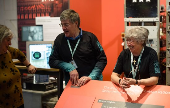 Two museum volunteers stood in front of a replica of the Baby computer