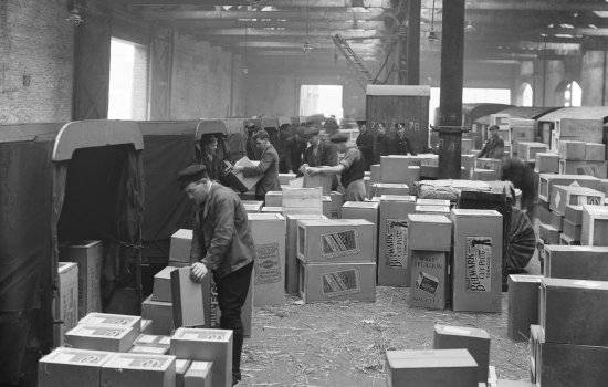 Boxes being unloaded in a warehouse
