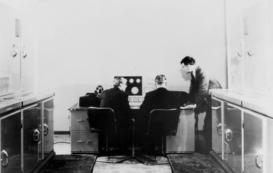 Alan M Turing and colleagues working on the Ferranti Mark I