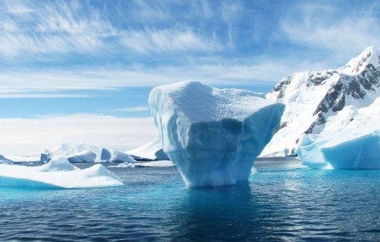 Glacier in snowy landscape