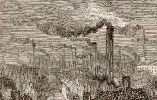 Grey chimneys billowing smoke over terraced housing