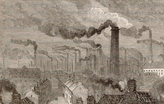 Grey chimneys billowing smoke over terraced housing