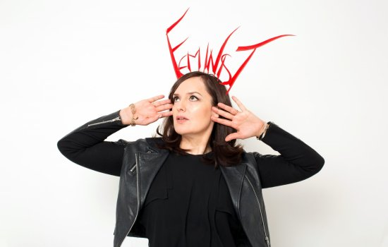 Deborah Frances-White, host of The Guilty Feminist, an award-winning podcast and live show