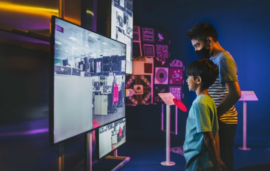 Two boys looking at a TV screen