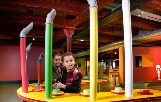 Two children playing on a museum interactive