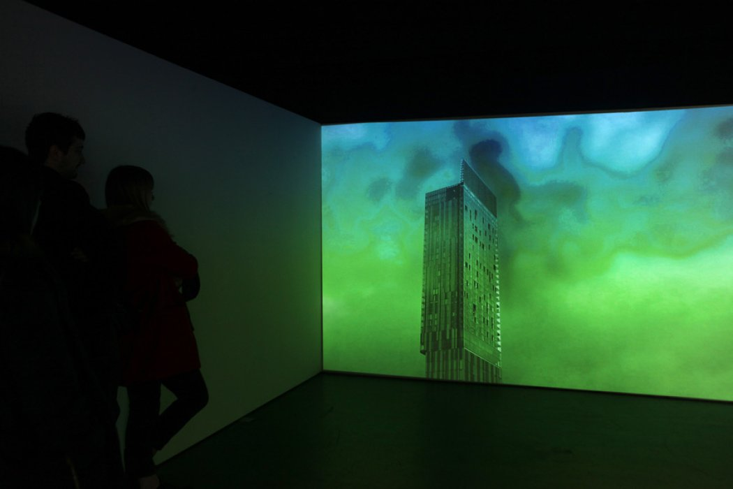 A screen with the Beetham Tower in green projected onto it