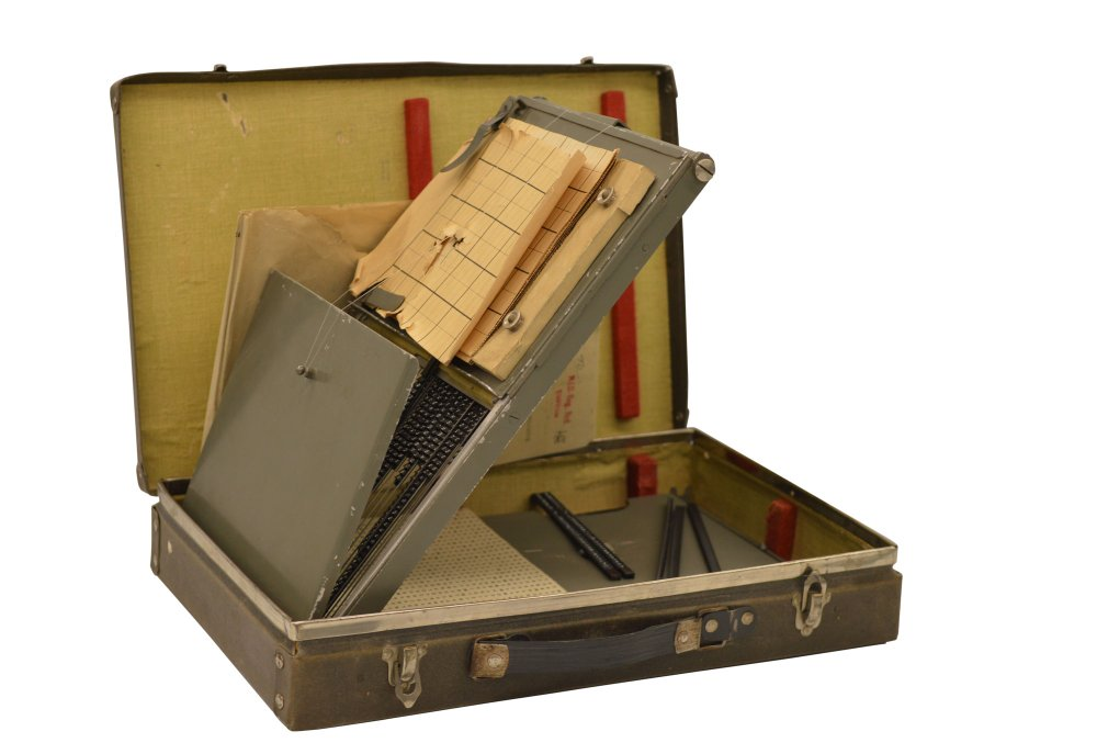 An open briefcase with the interior sections opened up
